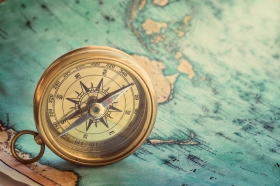 A compass sits on a map