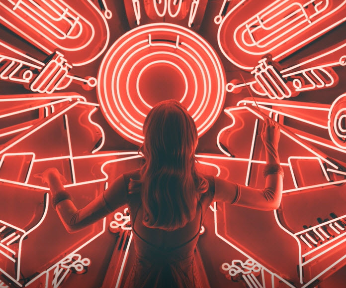 Image of girl in front of red circuitry