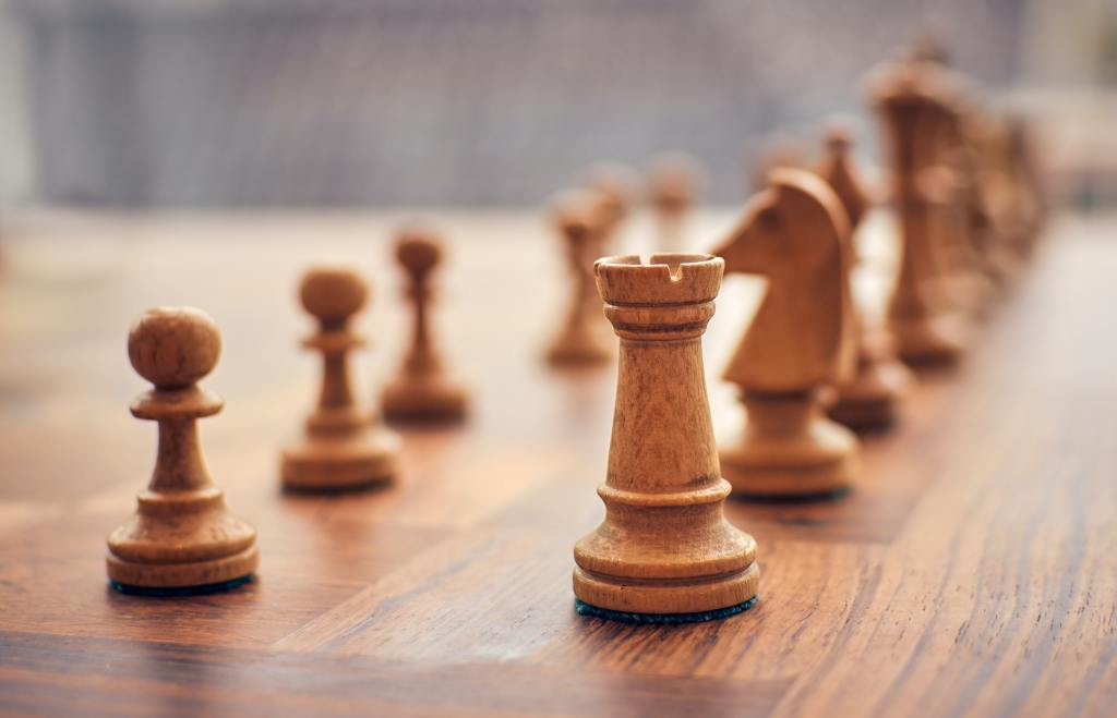 a close up of a chessboard with approximately 12 pieces on it