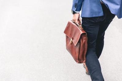 Man with bag walking away.