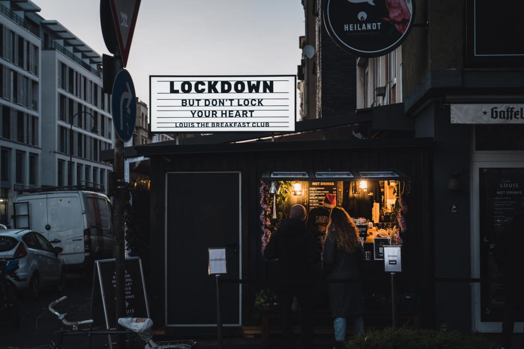 A sign reads 'Lockdown but don't lockdown your heart. Louis the breakfast club.'