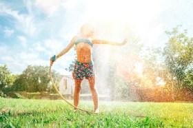 girl under sprinkler