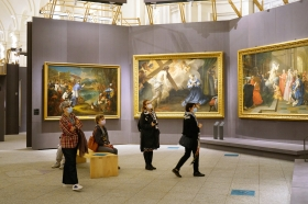 """Italy has eased the lockdown measures for the Covid-19 pandemic and many museums are reopening. Visitors look at the artworks of the exhibition """"Defying the Baroque"""". Turin, Italy - May 2020"""